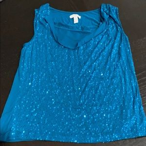 Sleeveless shirt in blue. Size petite / small